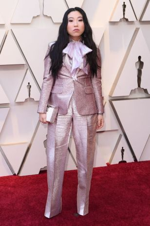 awkwafina in a baby pink sparkly suit