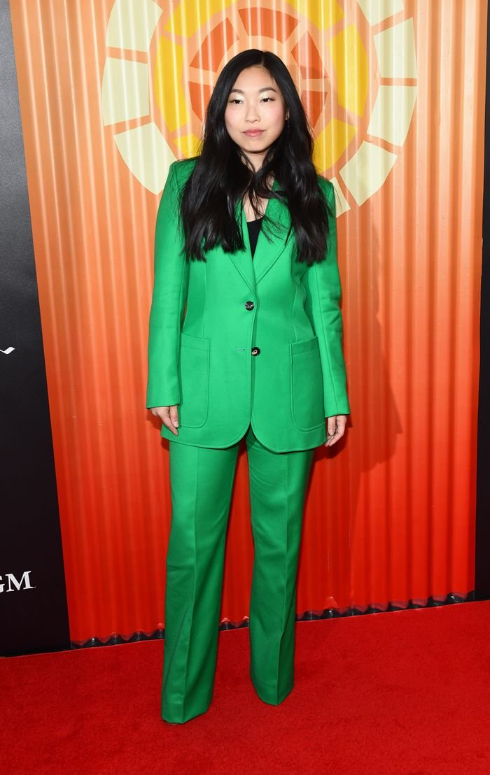 awkwafina in a bright green suit