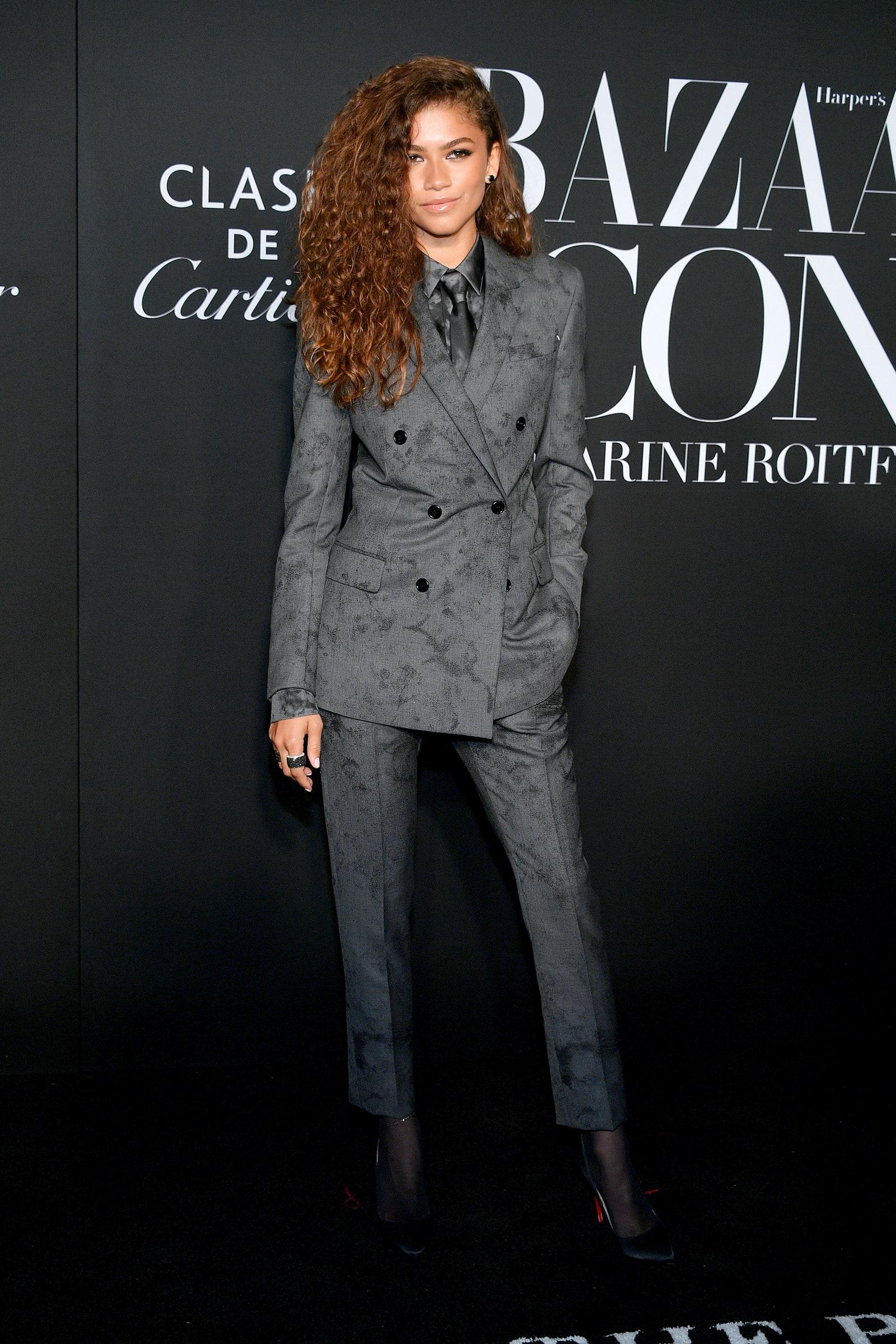 zendaya in a grey suit