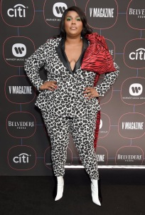 lizzo in an animal print suit