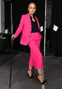 selma blair in a hot pink suit and using a cane