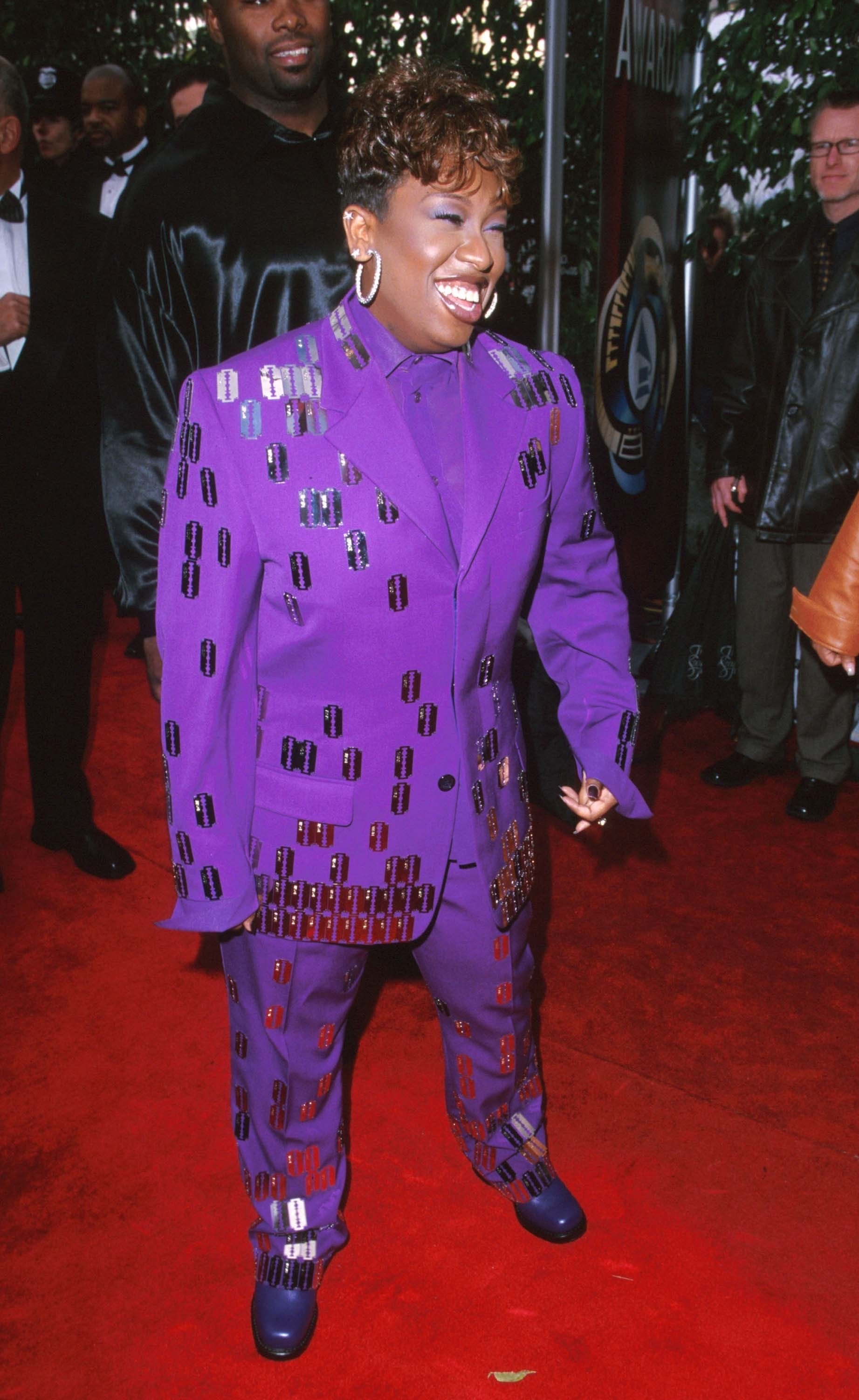 missy elliot in a purple suit with razor blades
