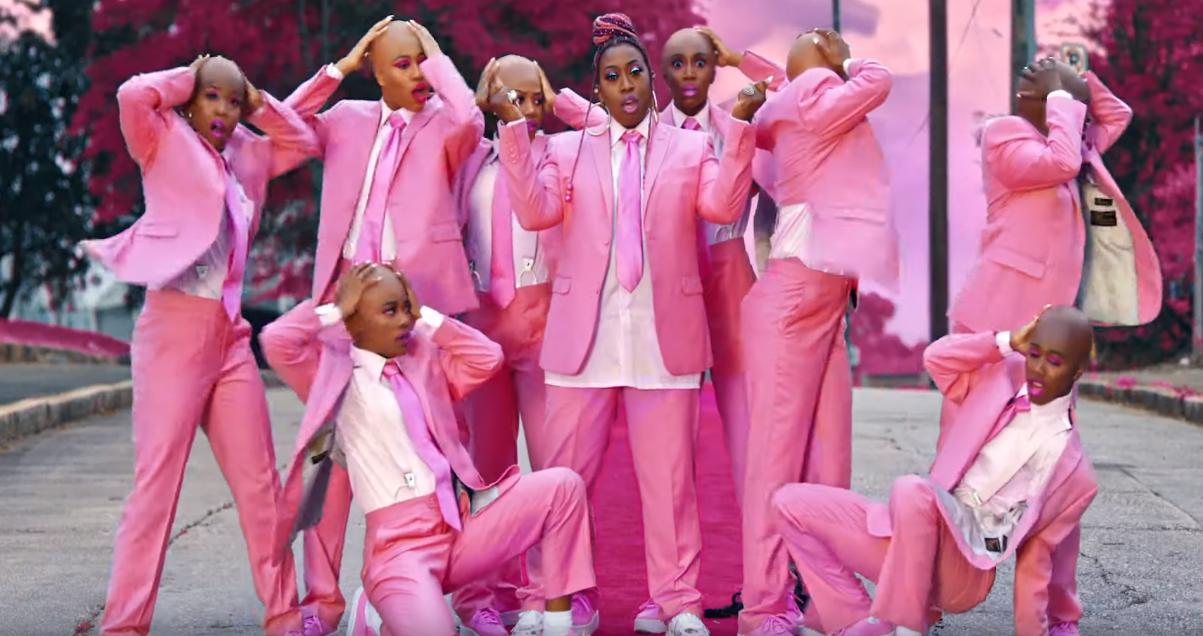 missy elliot and other Black women in bubblegum pink suit