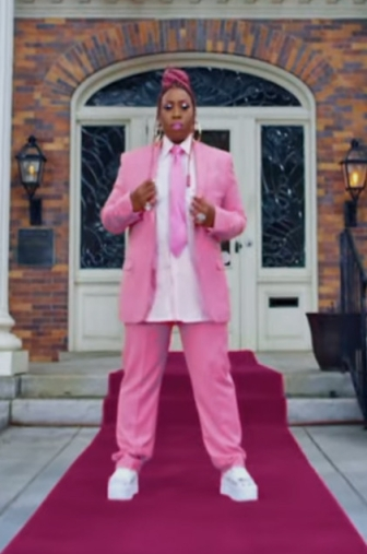 missy elliot in a bubblegum pink suit