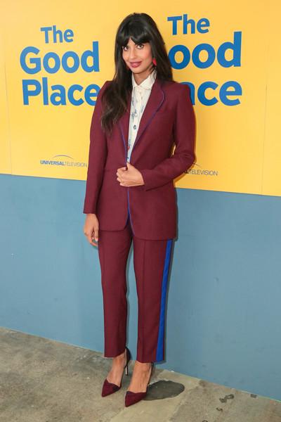jameela jamil in a burgundy suit