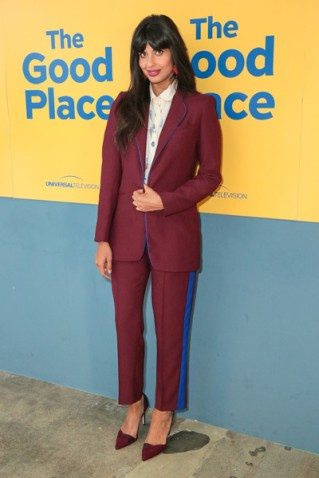 jameela jamil in a burgundy suit