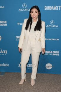 awkwafina in a white suit