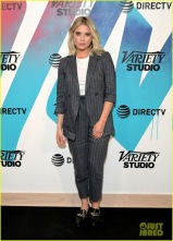 ashley benson in a grey striped suit