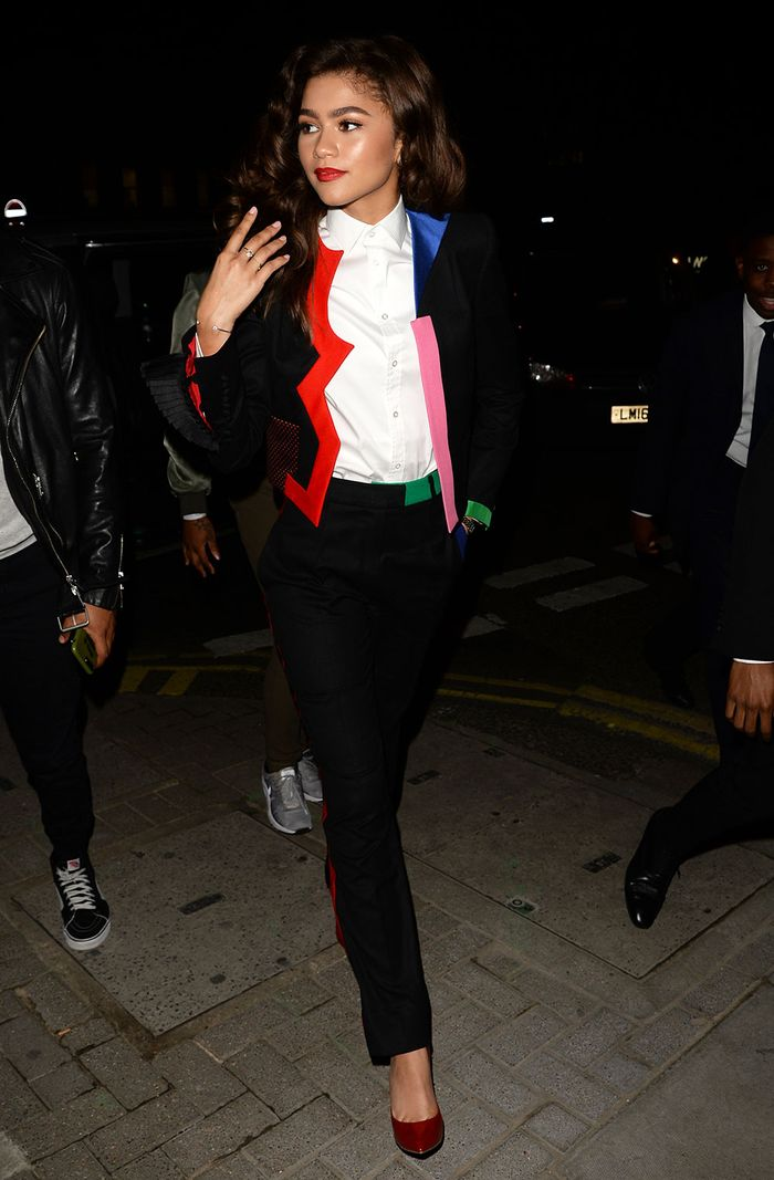 zendaya in a black suit with colour around the collar