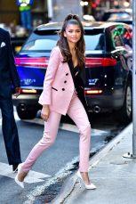 zendaya in a baby pink suit