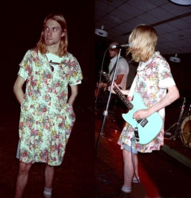 kurt cobain in a floral dress playing guitar and singing